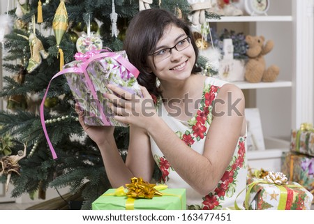 Girl is curious about contents of a gift box