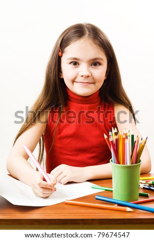 Girl is drawing with pencils - stock photo