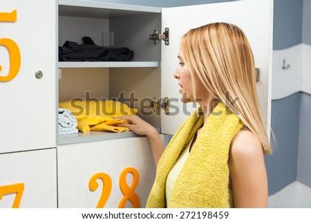 Girl is dressing for fitness training - stock photo