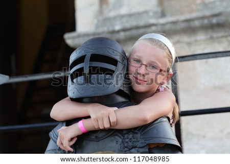 Girl is embracing the knight in Rhodes old town, Greece - stock photo