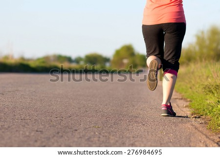 Girl is engaged in jogging