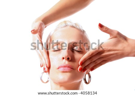 girl is enjoying in face treatment - stock photo