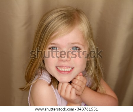 Girl is excited and happy giving a big grin - stock photo