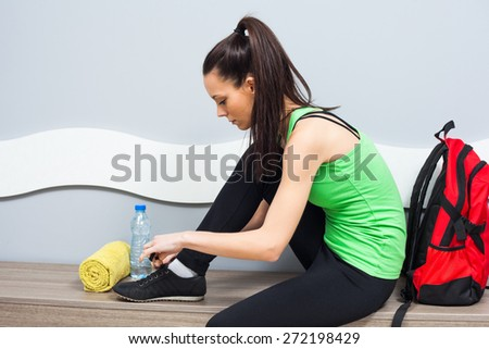 Girl is getting ready for fitness training - stock photo