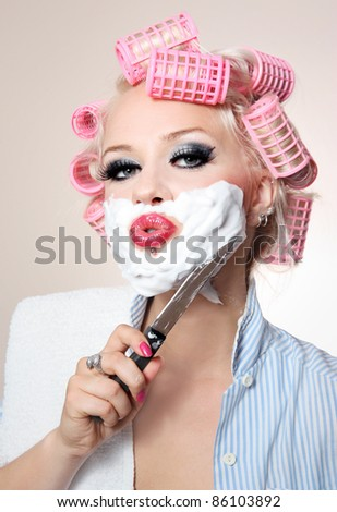 Girl is having a shave using knife - stock photo