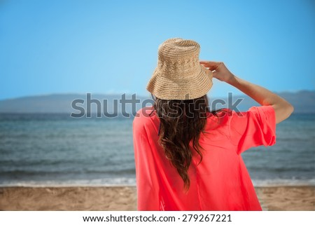 Girl is Holding her Hat - stock photo