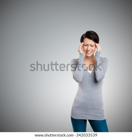 Girl is in despair trying to solve problems, isolated on grey - stock photo