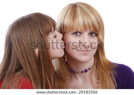Girl is kissing woman. Daughter's kiss. Daughter kissing her happy mother.  Isolated on white in studio. - stock photo