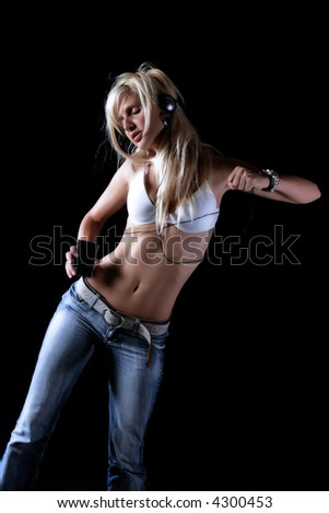 girl is listening music and dancing - stock photo