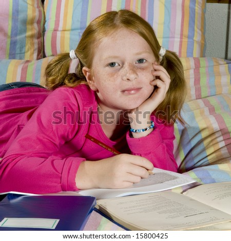 Girl is making homework from school - stock photo