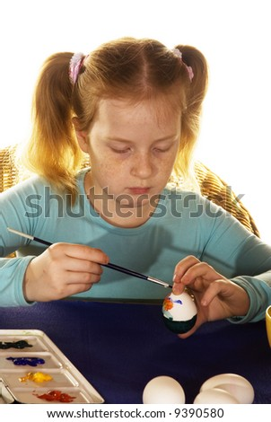 girl is painting easter eggs - stock photo