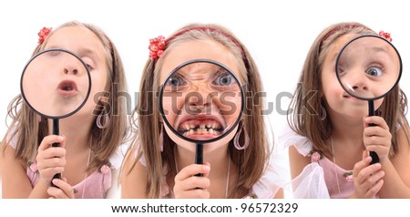girl is playing with magnify glass (kiss, eye, dentist visit) - stock photo