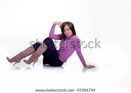 Girl is posing on the floor Isolated
