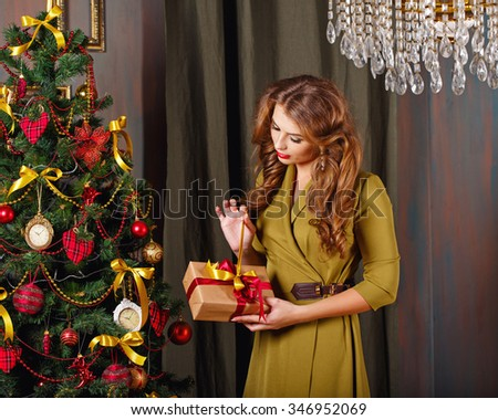 Girl is preparing gift. Christmas tree. New Year. Waiting for a miracle. Merry Christmas. - stock photo