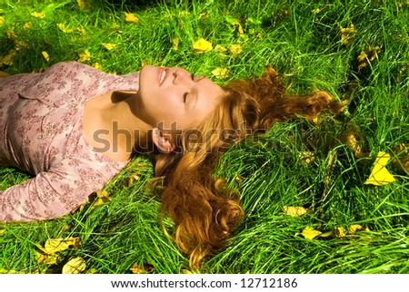 Girl is relaxing on the grass - stock photo