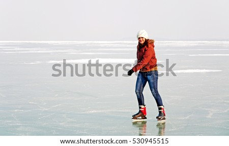 Girl is skateing on Lake Balaton, Hungary