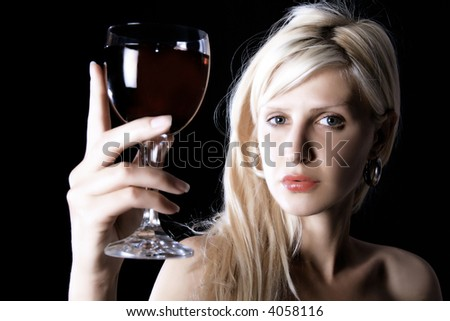 girl is standing and holding wine - stock photo