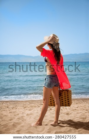 Girl is standing at the seaside she is on holiday - stock photo