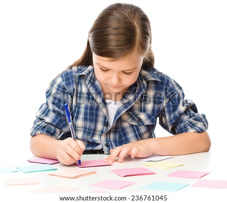 Girl is writing on color stickers using pen, planning concept, self-organization, isolated over white - stock photo