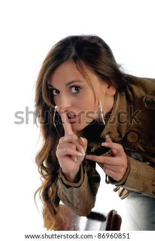 Girl isolated on white expressing Shhh or be quiet