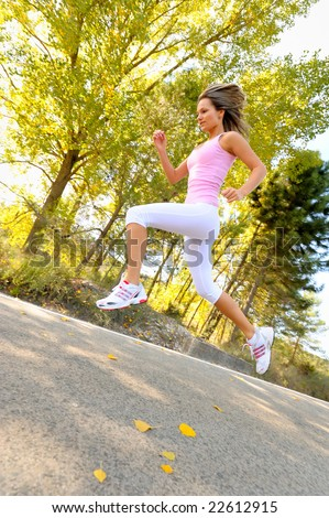 girl jogging/jumping on a road