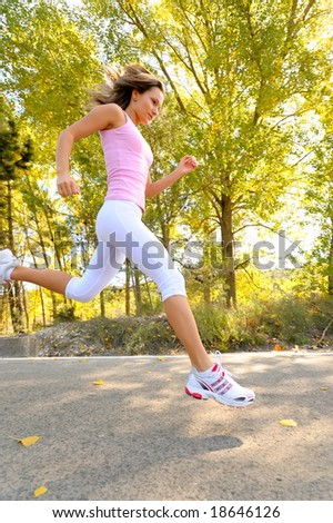 girl jogging on a road