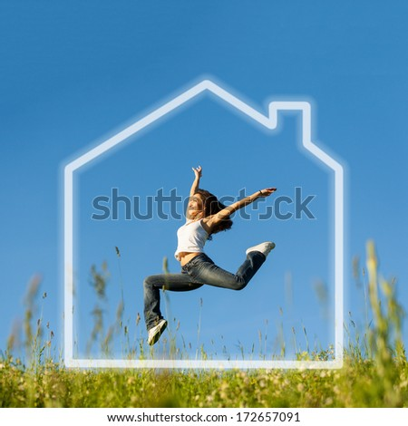 Girl jumping and celebrating in her abstract dream house  - stock photo