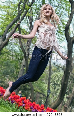 girl jumping in park