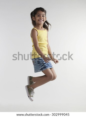 Girl jumping in the air - stock photo
