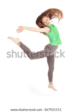 Girl jumping isolated on white studio background.