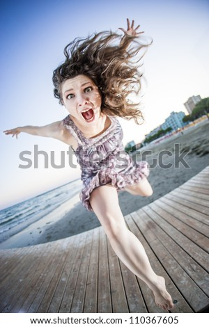 Girl jumping like an explosion - stock photo