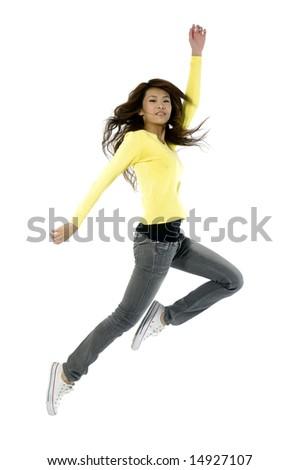 girl jumping of joy over white - stock photo