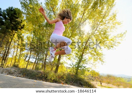 girl jumping on a road