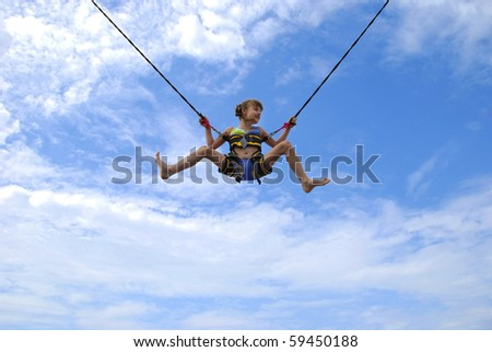 girl jumping on ropes relating to the blue sky