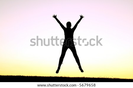 Girl jumping on the sunset - stock photo