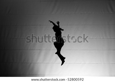 girl jumping on trampoline - stock photo