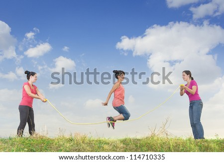 Girl jumping over a rope - stock photo