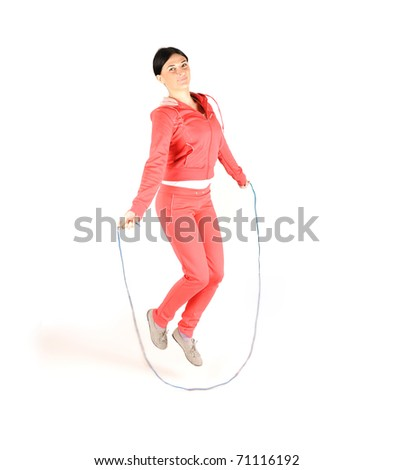 Girl jumping over rope, isolated on white - stock photo
