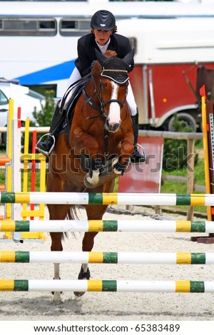girl jumping with horse - stock photo