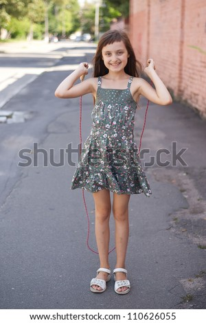 girl jumping with skipping rope