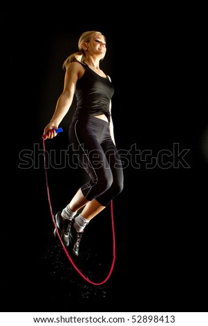 girl jumps on a skipping rope fitness - stock photo