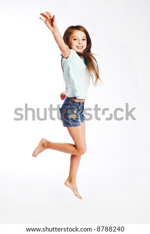 girl jumps on a white background - stock photo