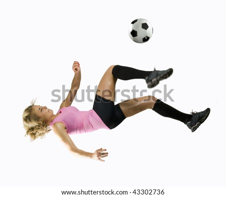 Girl Kicks soccer ball in mid air with a blank white background - stock photo