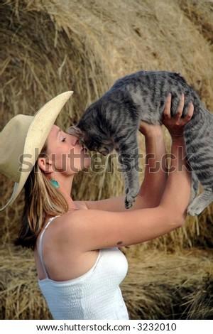 Girl kissin cat - stock photo
