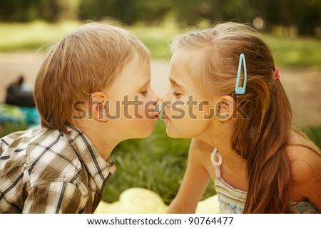 girl kissing a boy - stock photo