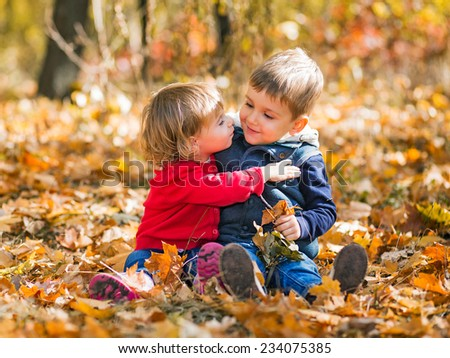 Girl kissing a boy outdoors