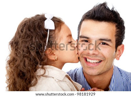 Girl kissing her father - isolated over a white background - stock photo