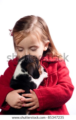 girl kissing her new puppy - stock photo