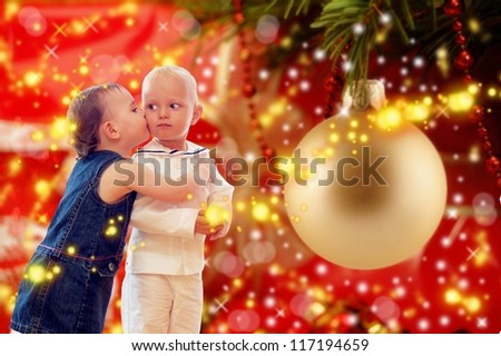 girl kissing sailor under x-mas tree - stock photo