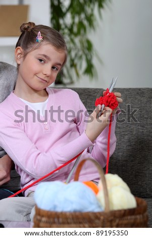 Girl knitting - stock photo